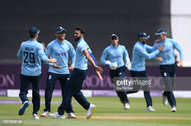 England bowler Saqib Mahmood celebrates with team mates after taking the wicket of Babar Azam caught by Zak Crawley for 0 during the 1st Royal London...