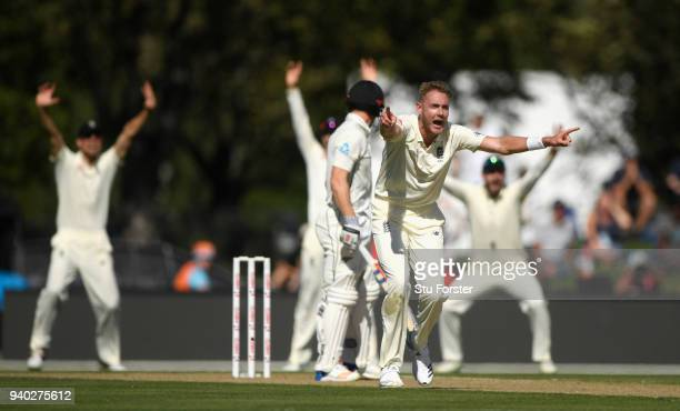 England bowler Stuart Broad appeals with success for the wicket of batsman Henry Nicholls who is given out after review during day two of the Second...