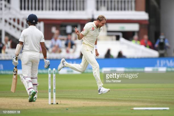 England bowler Stuart Broad celebrates after bowling India batsman Pujara during day 4 of the Second Test Match between England and India at Lord's...