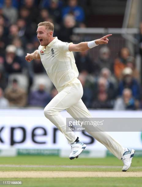 England bowler Stuart Broad celebrates after dismissing David Warner during day one of the 4th Ashes Test match between England and Australia at Old...