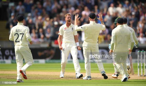 England bowler Stuart Broad celebrates after taking the wicket of David Warner in his first over during day one of the First Specsavers Ashes Test...