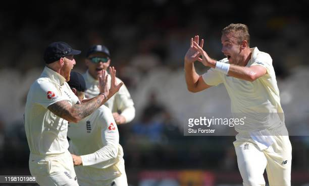 England bowler Stuart Broad celebrates with Ben Stokes after taking the wicket of South African batsman Rassie van der Dussen during Day Five of the...
