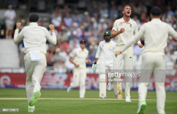 England bowler Stuart Broad celebrates with captain Joe Root after taking the wicket of Azhar Ali during day one of the second Test Match between...