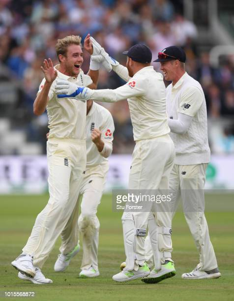 England bowler Stuart Broad celebrates with Jonny Bairstow after dismissing India batsman Dinesh Karthik during day 4 of the Second Test Match...