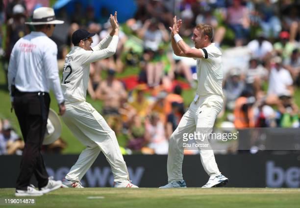 England bowler Stuart Broad celebrates with sub fielder Craig Overton after dismissing South Africa batsman Faf du Plessis picks up runs during Day...