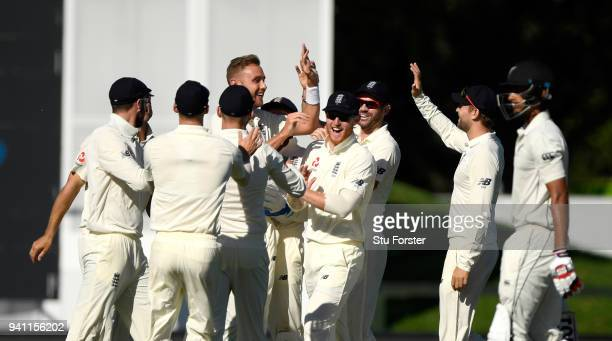 England bowler Stuart Broad celebrates with team mates after dismissing Jeet Raval with the first ball of the day during day five of the Second Test...