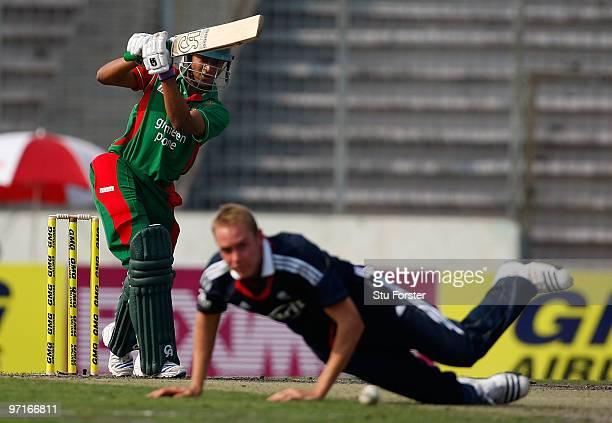England bowler Stuart Broad fields as Bangladesh batsman Shakib Al Hasan hits out during the 1st One Day International between Bangladesh and England...