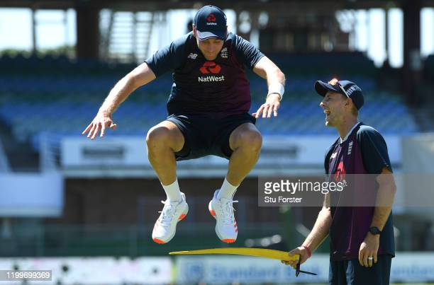 England bowler Stuart Broad jumps a bar held by Joe Root during England nets ahead of the 3rd Test Match against South Africa at St George's Park on...