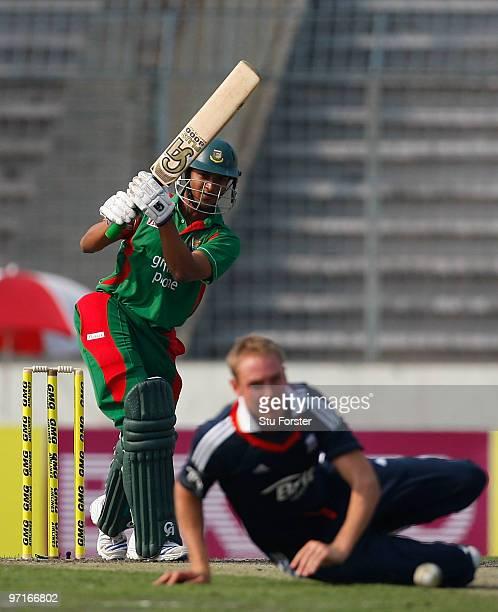 England bowler Stuart Broad looks on as Bangladesh batsman Shakib Al Hasan hits out during the 1st One Day International between Bangladesh and...