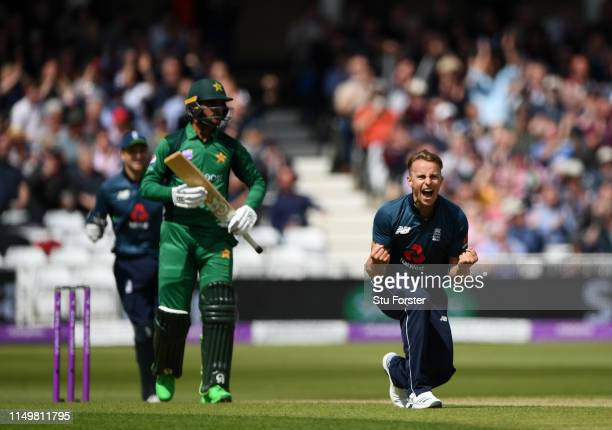 England bowler Tom Curran celebrates after taking the wicket of Pakistan batsman Fakhar Zaman during the 4TH One Day International between England...