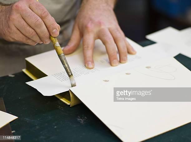 England, Bristol, Craftsman making book bindings