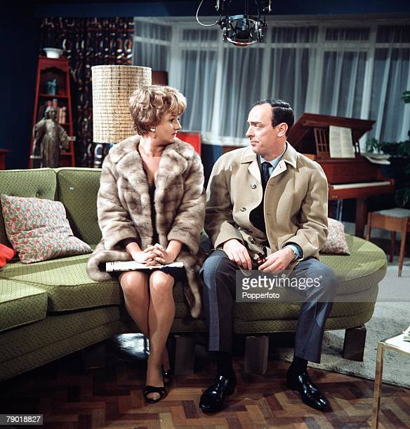 England British actor and actress John Junkin and Joan Sims are pictured in a scene from the television series Sam and Janet