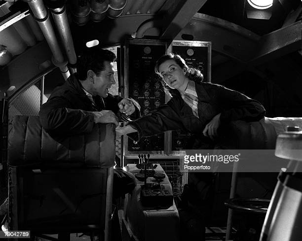 """England British actor Kieron Moore and actress Lois Maxwell are pictured in a scene from the film """"Flame in the Sky"""""""