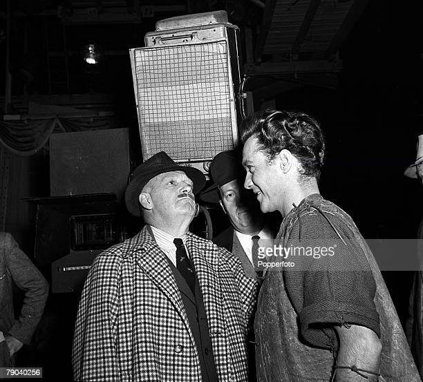 England British actor Richard Todd talks with Producer Perce Pearce on the set of the film 'Robin Hood'