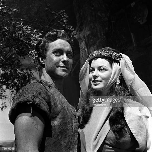 "England British actress and ex waitress Joan Rice is pictured with English film star Richard Todd on the set of the film ""Robin Hood"""