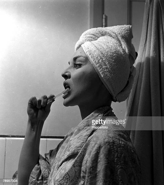 England British actress Diane Cilento is pictured brushing her teeth