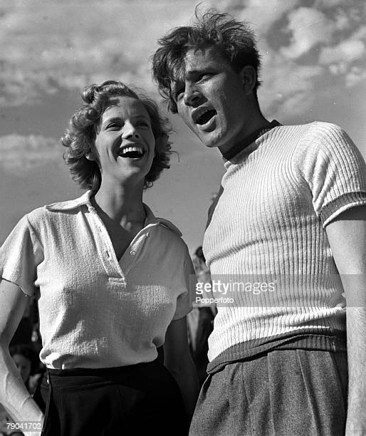 England British actress Honor Blackman and Welsh film star Richard Burton are pictured on the set of the film Green Grow the Rushes