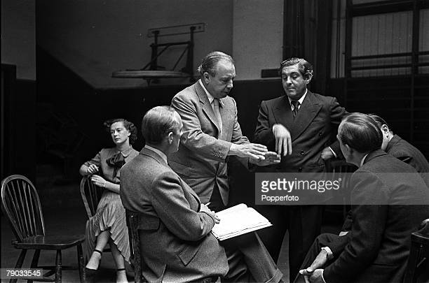 England British author and producer JB Priestley and director Henry Cass attempt to iron out a problem during rehearsals of the play Last Holiday...