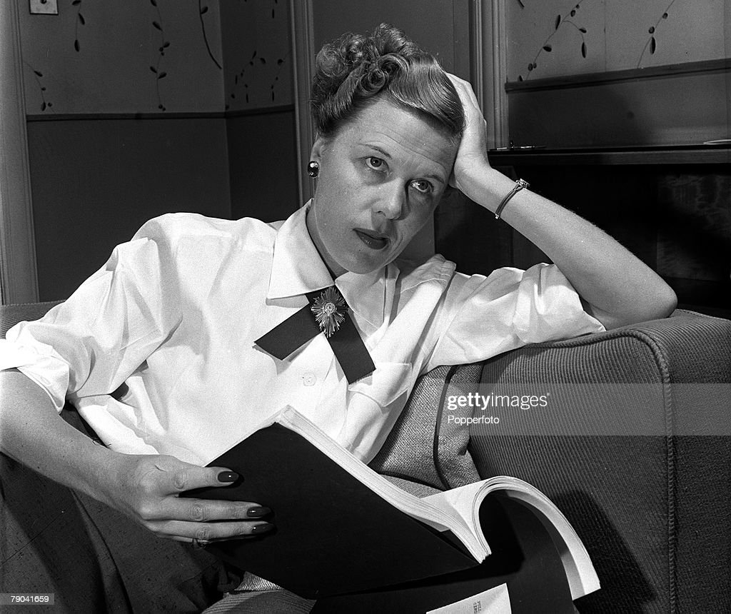England. 1950. British born Hollywood film producer Joan Harrison is pictured reading a manuscript. : News Photo