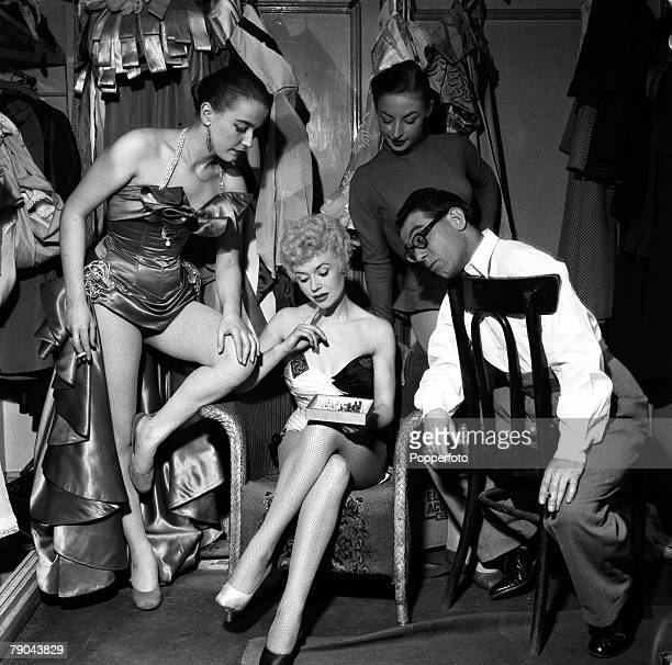 England British comedian and entertainer Peter Glaze is pictured in the dressing room at the Victoria Palace with three of the girls appearing in...