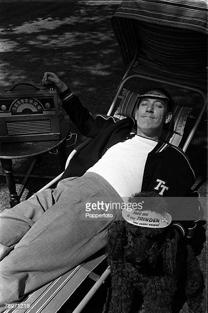 England British comedian Tommy Trinder is pictured listening to the radio as he sunbathes