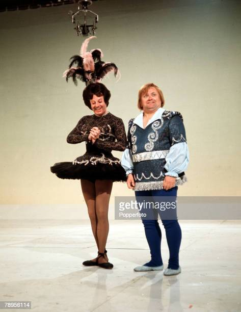 England British entertainer Danny La Rue is pictured with comedian Harry Secombe during the recording of a television sketch