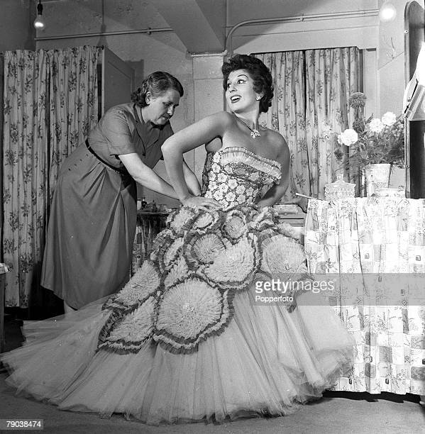 England British singer and entertainer Alma Cogan is pictured in her dressing room with her dresser