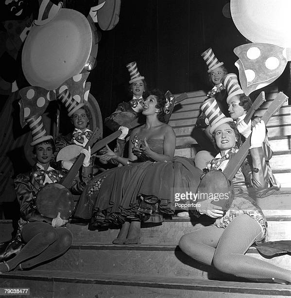 England British singer and entertainer Alma Cogan is surrounded by Tiller girls as she sings a Dixieland song on stage at the Blackpool Opera House