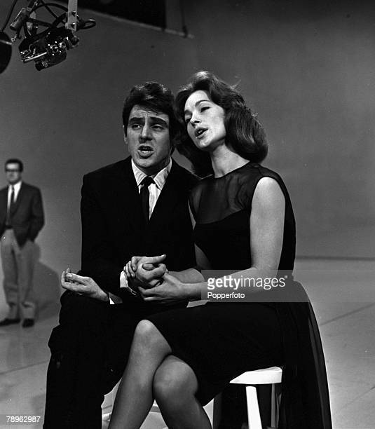 England British singers and actors Anthony Newley and Shirley Anne Field are pictured singing together on ATV's Saturday Spectacular television...
