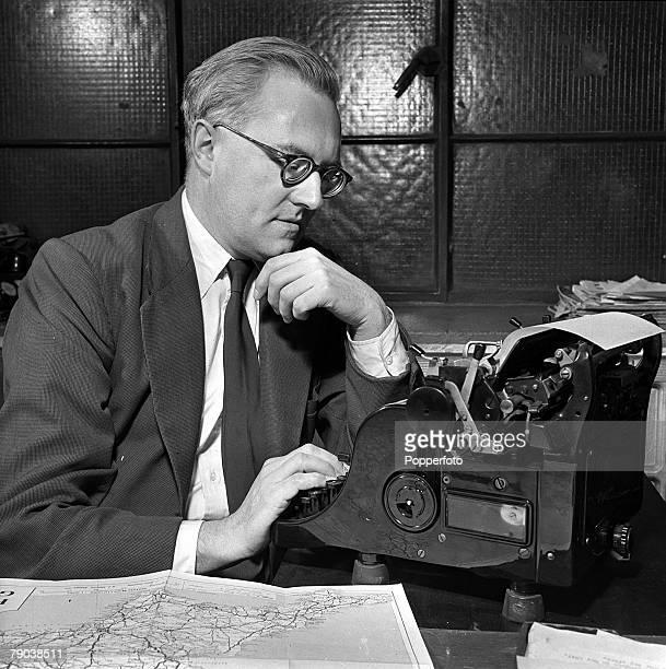England British writer Harry Hopkins is pictured sitting at his typewriter