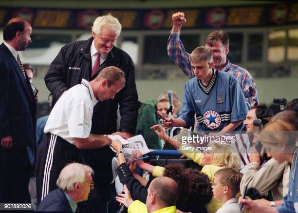 England captain Alan Shearer signs autographs for fans at his unveiling as a Newcastle United player for a then World Record fee of £15 Million at St...
