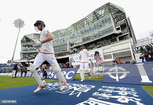 England captain Alastair Cook and Alex Hales walk out to bat ahead of day one of the 1st Investec Test match at Headingley on May 19 2016 in Leeds...
