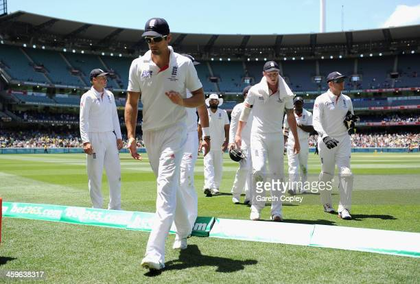 England captain Alastair Cook and his team leave the field for lunch during day four of the Fourth Ashes Test Match between Australia and England at...