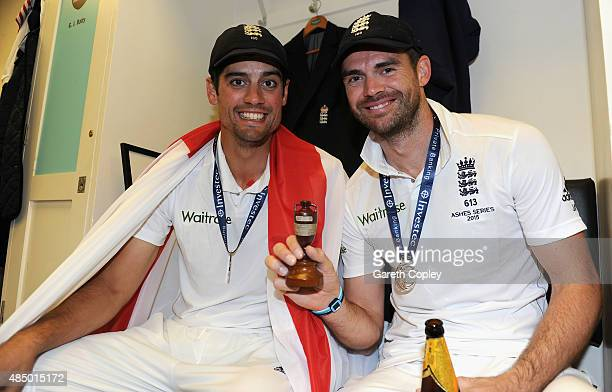England captain Alastair Cook and James Anderson celebrate with the ashes urn in the dressing rooms after the 5th Investec Ashes Test match between...