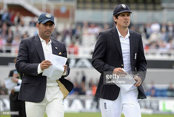 England captain Alastair Cook and Mahendra Singh Dhoni of India walk out for the toss ahead of day one of 5th Investec Test match between England and...