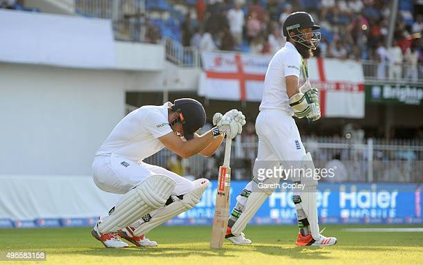 England captain Alastair Cook and Moeen Ali walk out to bat during day four of the 3rd Test between Pakistan and England at Sharjah Cricket Stadium...