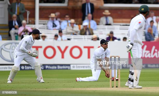 England captain Alastair Cook catches Pakistan batsman Shan Masood off the bowling of Chris Woakes during day three of the 1st Investec Test match...