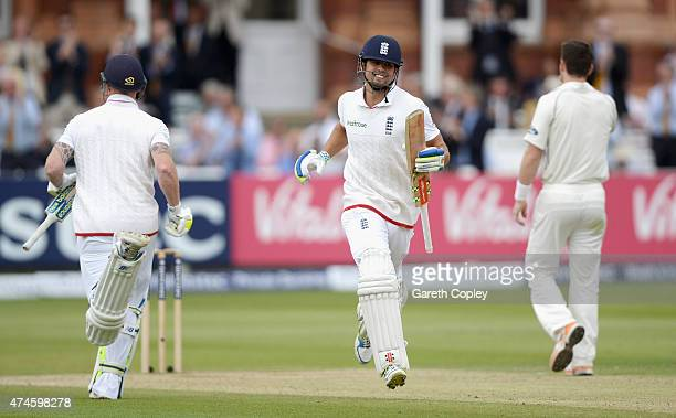 England captain Alastair Cook celebrates as he scores his century during day four of 1st Investec Test match between England and New Zealand at...