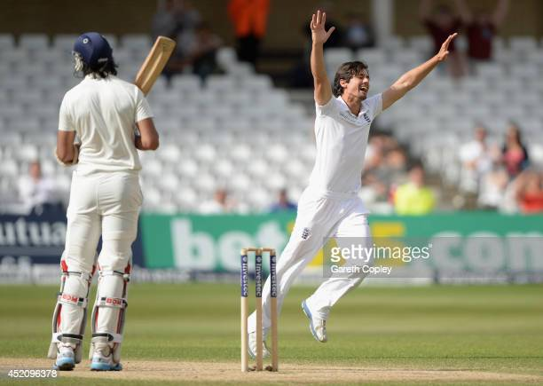 England captain Alastair Cook celebrates dismissing Ishant Sharma of India during day five of 1st Investec Test match between England and India at...