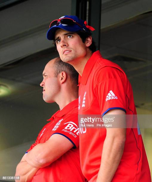 England captain Alastair Cook checks the weather from the players balcony as rain delays play during the ICC Champions Trophy Final at Edgbaston...