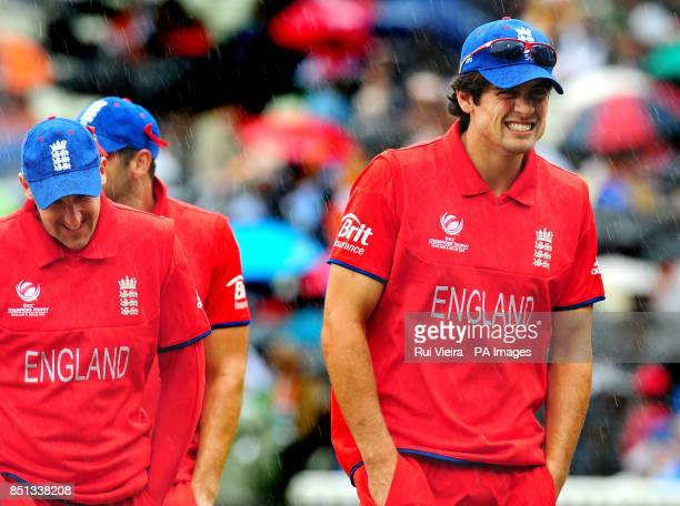 England captain Alastair Cook goes back to pavilion as rain delays play during the ICC Champions Trophy Final at Edgbaston Birmingham