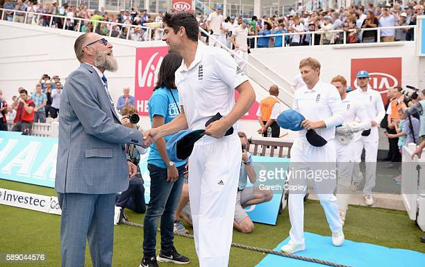 England captain Alastair Cook hands his cricket united cap to Graeme Fowler ahead of day three of the 4th Investec Test between England and Pakistan...