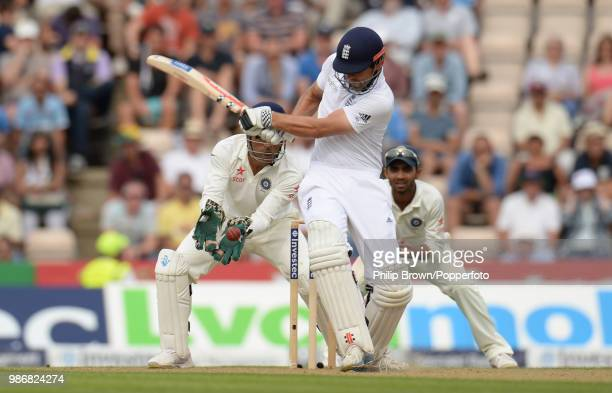 England captain Alastair Cook is caught behind for 95 runs by India's wicketkeeper captain Mahendra Singh Dhoni off the bowling of Ravi Jadeja during...