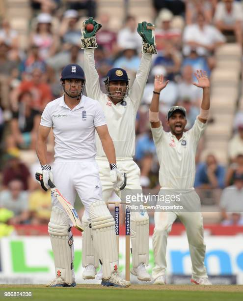 England captain Alastair Cook is dismissed for 95 runs caught behind by India's wicketkeeper captain Mahendra Singh Dhoni off the bowling of Ravi...