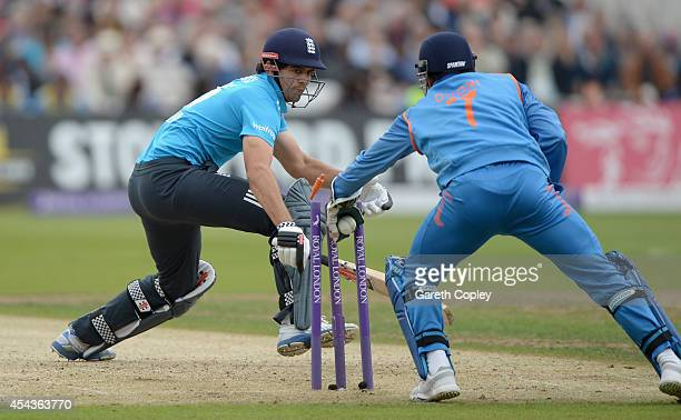 England captain Alastair Cook is stumped by Mahendra Singh Dhoni of India during the 3rd Royal London OneDay International match between England and...