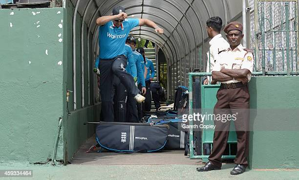 England captain Alastair Cook jumps over a kit bag as he leads out his team ahead of the tour match between between Sri Lanka A and England at...