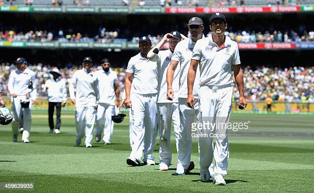 England captain Alastair Cook leads his team from the field after losing the Fourth Ashes Test Match between Australia and England at Melbourne...