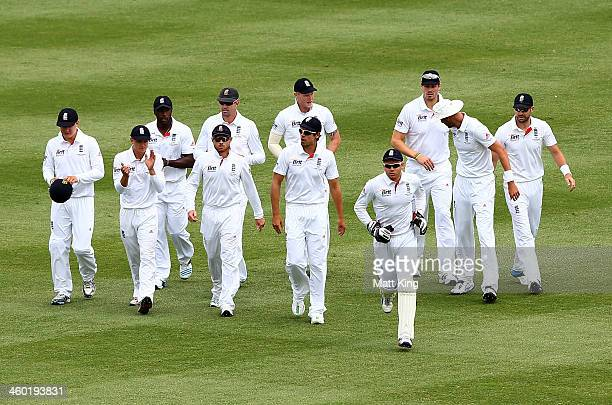 England captain Alastair Cook leads his team onto the field of play during day one of the Fifth Ashes Test match between Australia and England at...