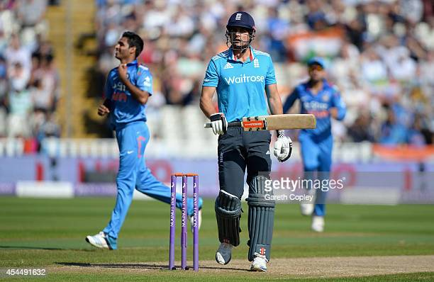 England captain Alastair Cook leaves the field after being dismissed by Bhuvneshwar Kumar of India during the 4th Royal London One Day International...