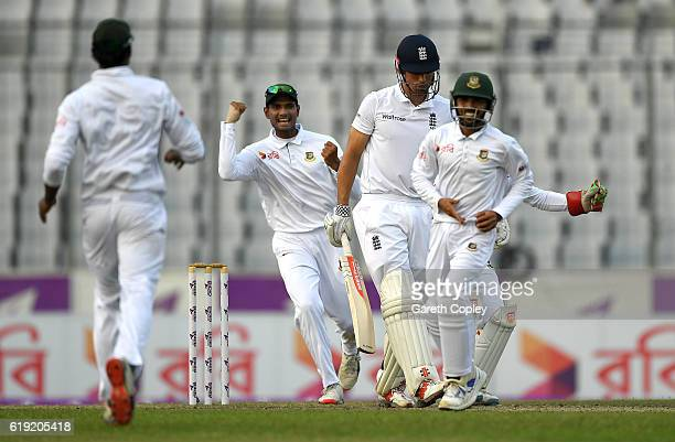 England captain Alastair Cook leaves the field after being dismissed by Mehedi Hasan of Bangladesh during day three of the second Test match between...